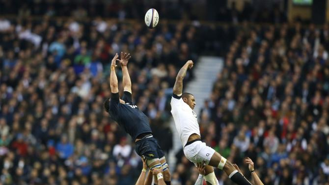 England's Lawes jumps for the line out ball with Argentina's Cabello during their international rugby union match in London