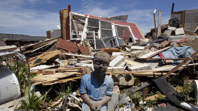 A small statue stares out from the wreckage of the Rosedale Community in Tuscaloosa, Ala., Thursday, May 5, 2011. Authorities continue the search for victims among the rubble over a week after a killer tornado decimated the town.  (AP Photo/Dave Martin)