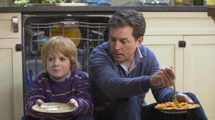 "This image released by NBC shows Jack Gore as Graham Henry, left, and Michael J. Fox as Mike Henry in ""The Michael J. Fox Show,"" premiering Sept. 26. (AP Photo/NBC, Eric Liebowitz)"