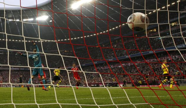 Borussia Dortmund's Hofmann scores a goal during German Bundesliga first division soccer match against Bayern Munich in Munich