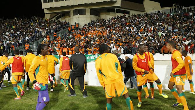 Ivory Coast's soccer team dances in front of supporters after wining their World Cup qualifying match against Senegal at Mohammed V stadium in Casablanca, Morocco, Saturday Nov. 16, 2013. Ivory Coast qualified for the World Cup tournament by beating Senegal 4-2 on aggregate in a playoff for next year's finals in Brazil after a 1-1 draw