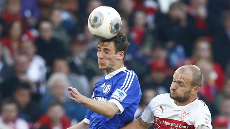 Stuttgart's Rausch and Schalke 04's Goretzka head for the ball during their German Bundesliga first division soccer match in Stuttgart