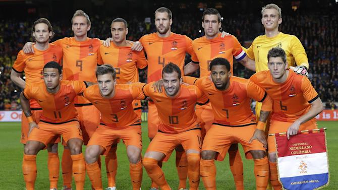 Netherlands' Daley Blind, Siem de Jong, Gregory van der Wiel, Ron Vlaar, Kevin Strootman, goalkeeper Jasper Cillessen, rear row from left, Memphis Depay, Joel Veltman, Rafael van der Vaart, Jeremain Lens and Stijn Schaars, front row from left, pose for the team photo ahead of the international friendly soccer match between Netherlands and Colombia at ArenA stadium in Amsterdam, Netherlands, Tuesday Nov. 19, 2013