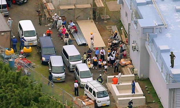 Evacuees gather at a shelter after Mount Shindake erupted on Kuchinoerabu island, southern Japan, Friday, May 29, 2015. The volcano erupted in spectacular fashion on the small island on Friday, spewin