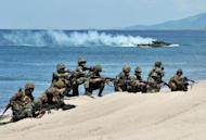 US and Philippine Marines simulate an amphibious landing as part of RP-US Amphibious Landing Exercise at the beach in San Antonio, Zambales province, north of Manila, in 2011. The Philippines said it would hold large-scale military exercises with the United States