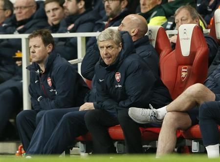 Arsenal manager Arsene Wenger watches play during their English Premier League soccer match against Swansea City at the Emirates stadium in London