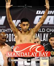 British boxer Amir Khan on the scales during the official weigh-in on July 13 in Las Vegas. Khan knows that another defeat after the Lamont Peterson loss would push unbeaten Danny Garcia ahead of him on many promoters' lists