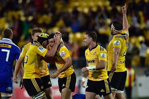 The Wellington Hurricanes players celebrate win against the Western Stormers during their Super 15 rugby union match, at Westpac Stadium in Wellington, in April 2015
