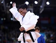 Cuba's Yanet Bermoy Acosta (white) celebrates after winning against Belgium's Ilse Heylen (blue) during their women's -52kg contest semi-final match of the judo event at the London 2012 Olympic Games on July 29, 2012 ExCel arena in London. AFP PHOTO / FRANCK FIFE