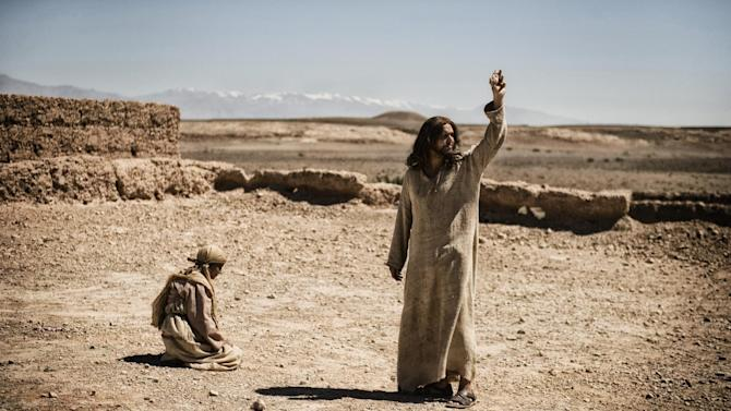 "This publicity image released by History shows Diogo Morcaldo as Jesus, right, in a scene from ""The Bible,"" on History. The producers of the cable TV miniseries on the Bible say Internet chatter that their Satan character resembles President Barack Obama is ""utter nonsense."" Mark Burnett and Roma Burnett said Monday the Moroccan actor who played Satan in the History channel series has played Satanic characters in other Biblical programs long before Obama was elected president. (AP Photo/History, Joe Alblas)"