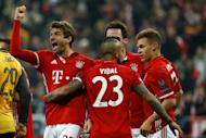 Bayern Munich's forward Thomas Mueller (L) celebrates scoring the 5-1 goal with his teammates during the UEFA Champions League round of sixteen football match against Arsenal February 15, 2017