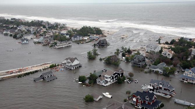 FILE - This Oct. 30, 2012 aerial file photo provided by the U.S. Air Force shows flooding on the New Jersey shoreline caused by Superstorm Sandy. The unprecedented storm surge caused by the storm caused the National Oceanic and Atmospheric Administration to increase the number of storm surge forecasters at the National Hurricane Center starting with the 2013 Atlantic Hurricane season. They will also provide potential storm surge hazards at least 48 hours before the onset of tropical storm or gale-force winds. (AP Photo/U.S. Air Force, Master Sgt. Mark C. Olsen, File)