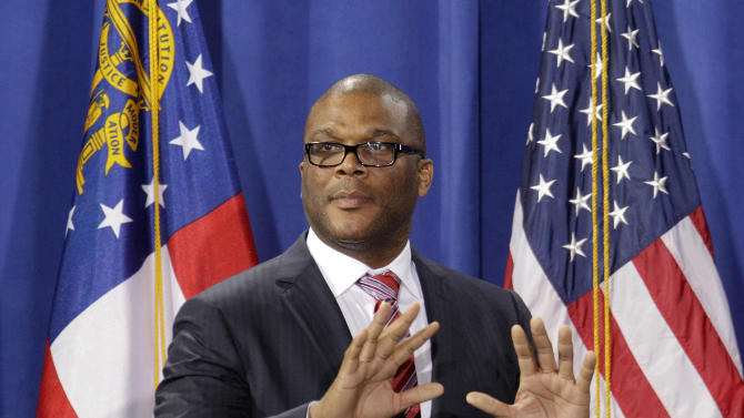 Actor Tyler Perry takes the stage to introduce President Barack Obama  during a fundraiser at Perry's film studio Friday, March 16, 2012, in Atlanta. (AP Photo/David Goldman)