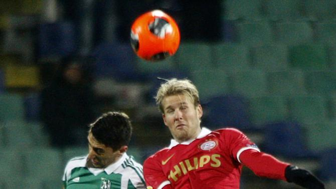 PSV Eindhoven's Ola Toivonen, right, jumps for the ball along with Ludogorets' Mihail Aleksandrovi, left, during a Europa League group B soccer match between Ludogorets and PSV Eindhoven at the Vassil Levski Stadium in Sofia, Bulgaria, Thursday, Nov. 28, 2013. (AP Photo)