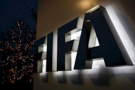 The FIFA logo is seen outside the FIFA headquarters in Zurich