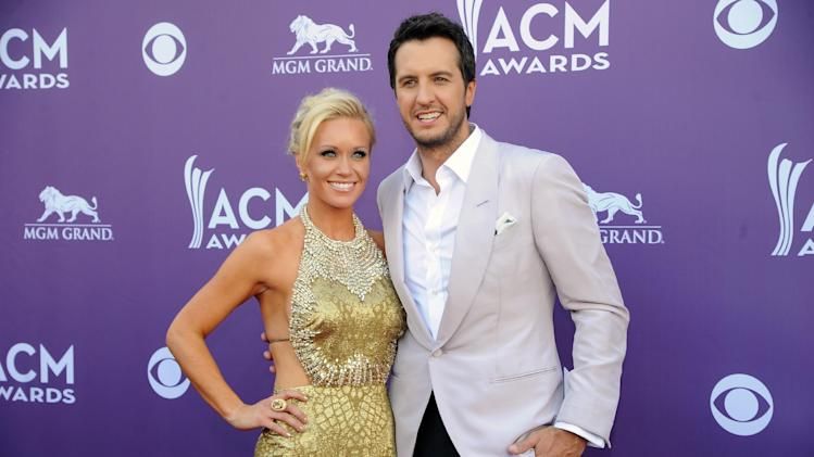 Singer Luke Bryan, right, and Caroline Bryan arrive at the 48th Annual Academy of Country Music Awards at the MGM Grand Garden Arena in Las Vegas on Sunday, April 7, 2013. (Photo by Al Powers/Invision/AP)