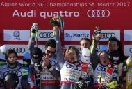 Alpine Skiing - FIS Alpine Skiing World Championships - Alpine Team Event - St. Moritz, Switzerland - 14/2/17 - Slovakia's Andreas Zampa (L) looks on as (2nd L to R) France's Mathieu Faivre, Adeline Baud Mugnier, Alexis Pinturault, Tessa Worley and Nastasia Noens celebrate winning gold during the flower ceremony following the final of the parallel slalom Mixed Team event. REUTERS/Denis Balibouse