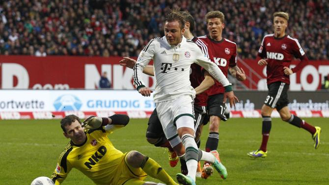 Bayern Munich's Goetze tries to score against Nuremberg's goalkeeper Schaefer during German Bundesliga soccer match in Nuremberg