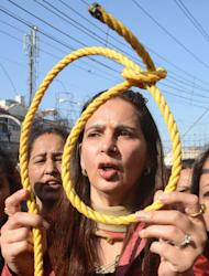 Indian politician Navjot Kaur Sidhu (centre) holds a noose as activists shout slogans during a demonstration in Amritsar on December 19, 2012. The rally was organised following the gang-rape of a student in New Delhi on December 16, which has sparked new calls for greater security for women across India