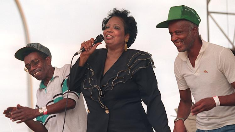 "In this Sept. 2, 1995 photo, Fontella Bass dances with Vernon Harris and Curtis Berry on the stage as she sings her 1965 hit ""Resuce Me"" at the St. Louis Blues Heritage Festival. The St. Louis-born soul singer who hit the top of the R&B charts with ""Rescue Me"" in 1965, died Wednesday, Dec. 26, 2012, of complications from a heart attack suffered three weeks ago. She was 72. (AP Photo/St. Louis Post-Dispatch, Odell Mitchell Jr.)  EDWARDSVILLE INTELLIGENCER OUT; THE ALTON TELEGRAPH OUT"