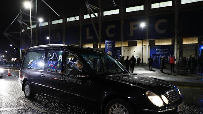 A hearse is seen outside the stadium ahead of the game