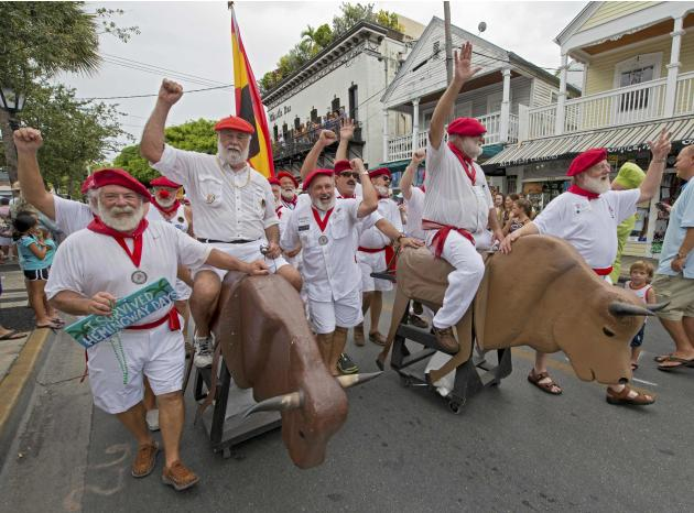 "Handout of participants  in the annual Ernest Hemingway Look-Alike Contest proceed on Duval Street during the annual ""Running of the Bulls"" in Key West"