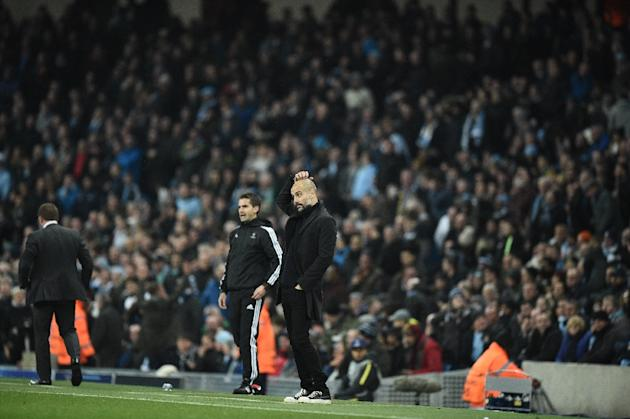Manchester City's manager Pep Guardiola reacts as Manchester City's midfielder Nolito is called to be off-side after scoring during the UEFA Champions League group C football match between Man