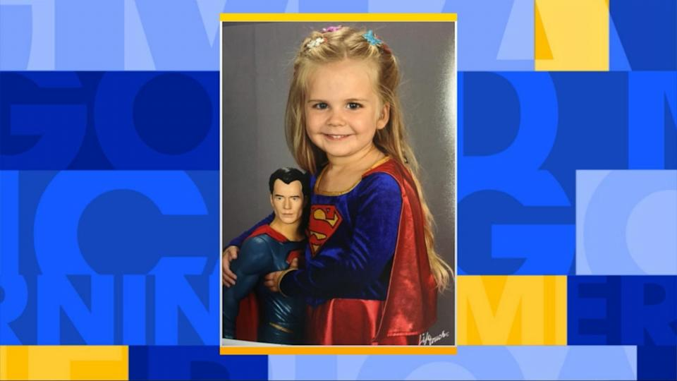 Little Girl Wears Superman Costume for School Picture Day