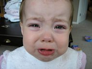 Crying child. Separation is not an easy phase to go through. Being consistent is key to coping with separation anxiety.