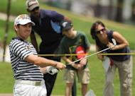South Africa's Louis Oosthuizen hits a shot during the second round of the Maybank Malaysian Open at Kuala Lumpur Golf and Country Club. Oosthuizen dodged thunderous rainstorms to hold a one-shot lead at the Maybank Malaysian Open before play was washed out for a second day running on Saturday