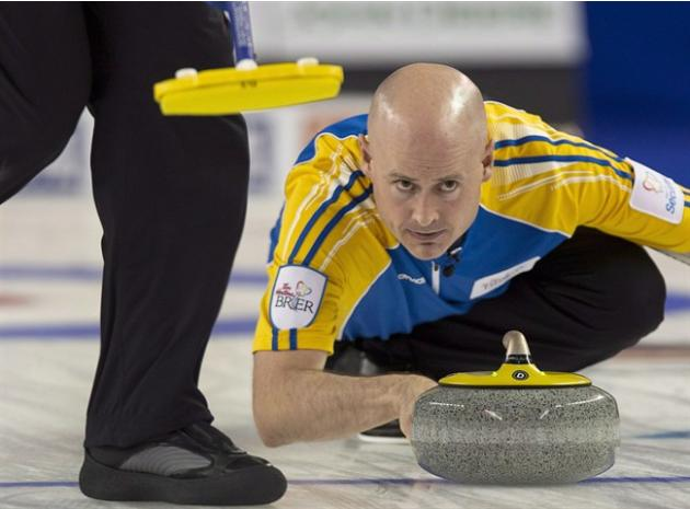 Alberta skip Kevin Koe releases a rock against British Columbia in the gold medal game at the Tim Hortons Brier in Kamloops, B.C. on Sunday, March 9, 2014. Koe is trying his best to avoid distractions