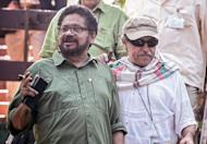 FARC Commanders Ivan Marquez (L) and Jesus Santrich (R), members of the FARC-EP peace talks delegation, arrive for a press conference, on February 10, 2013 in Havana