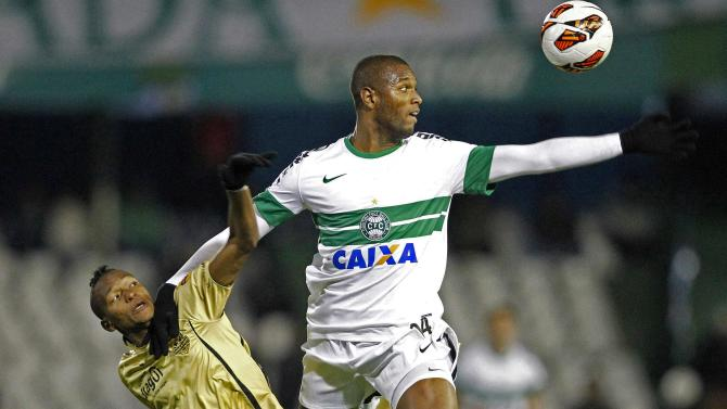 Bomfim of Brazil's Coritiba battles Quinones of Colombia's Itagui during their Copa Sudamericana soccer match in Curitiba