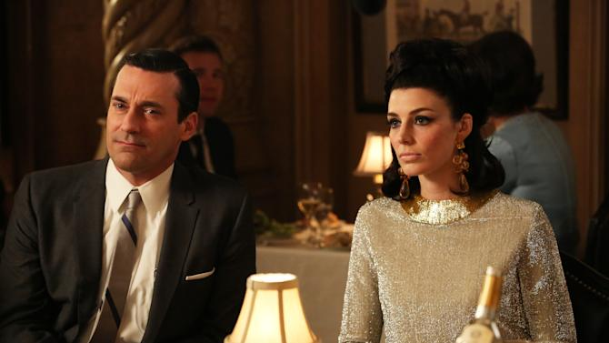 "This TV publicity image released by AMC shows Jon Hamm as Don Draper, left, and Jessica Pare as Megan Draper in a scene from ""Mad Men."" The season finale airs Sunday, June 23, on AMC. (AP Photo/AMC, Michael Yarish)"