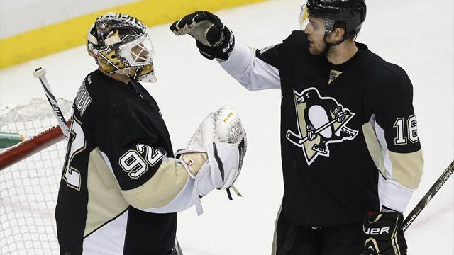 Ice Hockey - Penguins cruise past Senators in opener