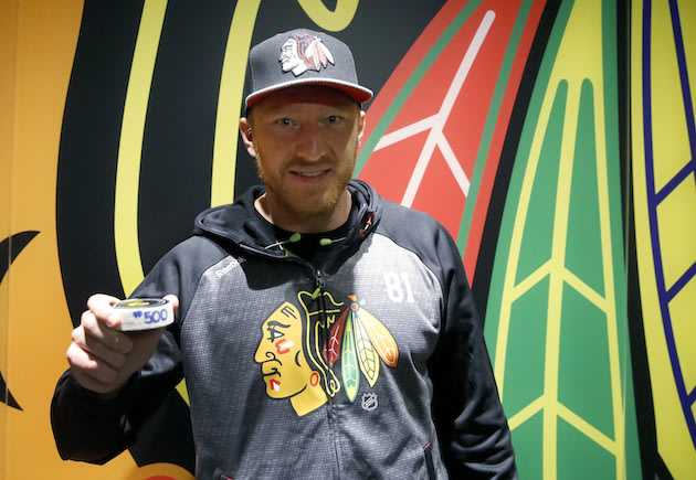 Chicago Blackhawks right wing Marian Hossa poses with his 500th career goal puck after an NHL hockey game against Philadelphia Flyers Tuesday, Oct. 18, 2016, in Chicago. The Blackhawks won 7-4. (AP Photo/Charles Rex Arbogast)