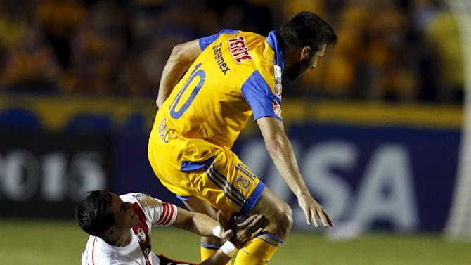 Ramiro Mori of Argentina's River Plate battles for the ball with Andre Gignac of Mexico's Tigres during the first leg of their Copa Libertadores final soccer match at the Universitario stadium in Monterrey