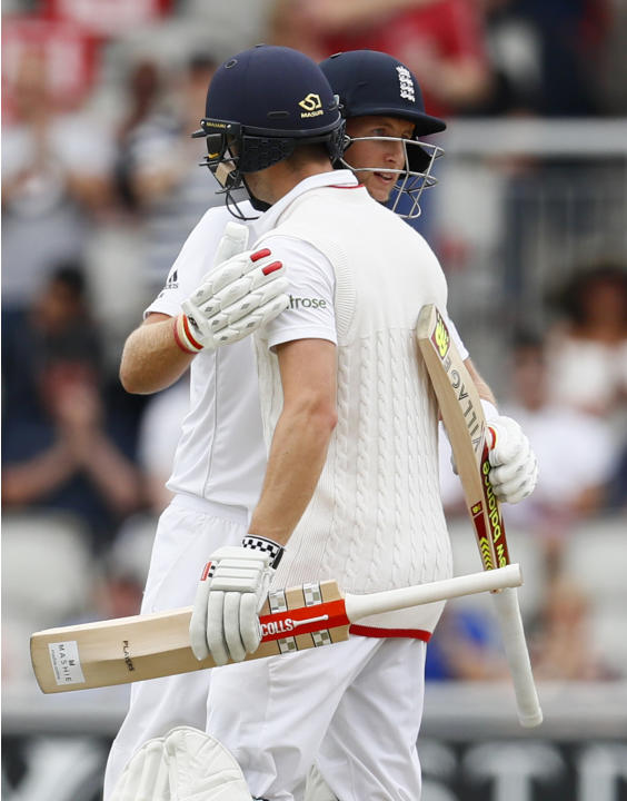 England's Joe Root celebrates scoring 150 runs with Chris Woakes