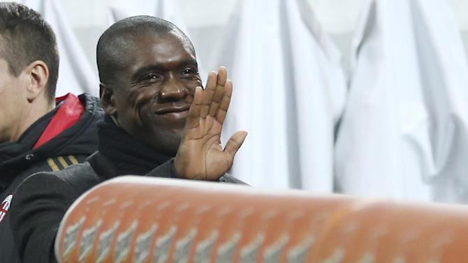 AC Milan coach Clarence Seedorf, of the Netherlands, waves prior to the start of the Italian Cup soccer match between AC Milan and Udinese at the San Siro stadium in Milan, Italy, Wednesday, Jan. 22, 2014