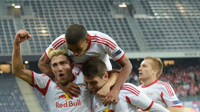 Salzburg's Kevin Kampl, Alan  and Jonatan Soriano,  from left, celebrate after scoring  during the Europa League group C soccer match  between Red  Bull Salzburg and Standard Liege  in Salzburg, Austria, Thursday, Oct.  24, 2013