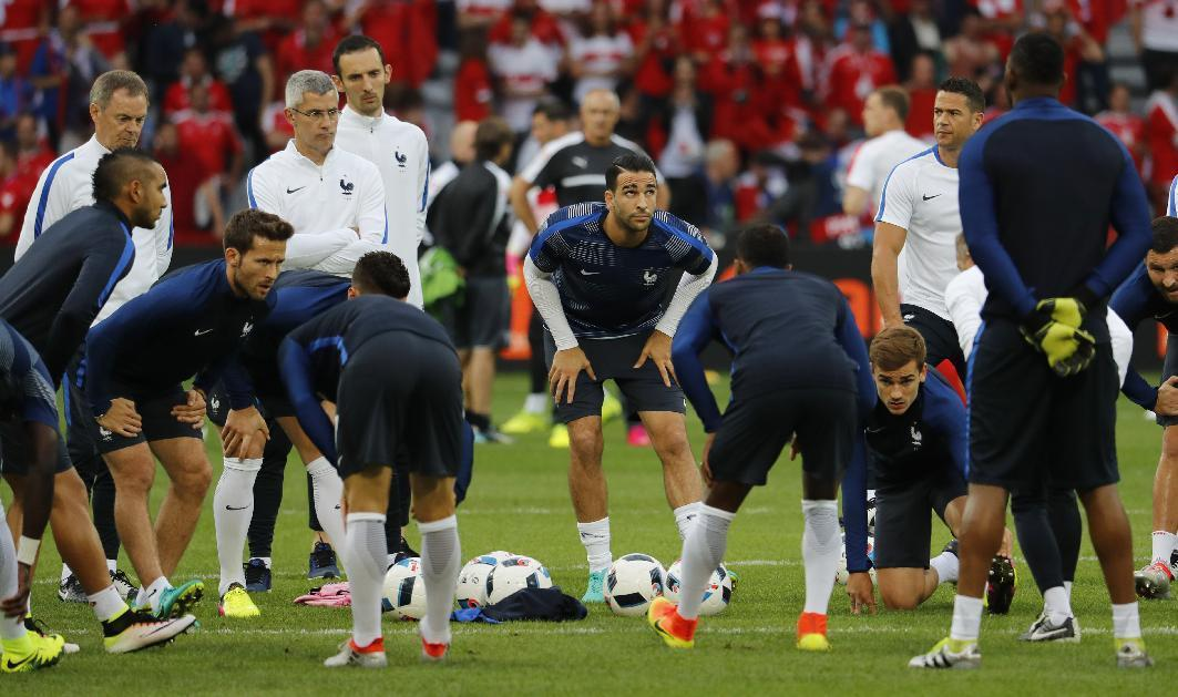 France's Adil Rami (C), Yohan Cabaye and Antoine Griezmann  warm up before the game