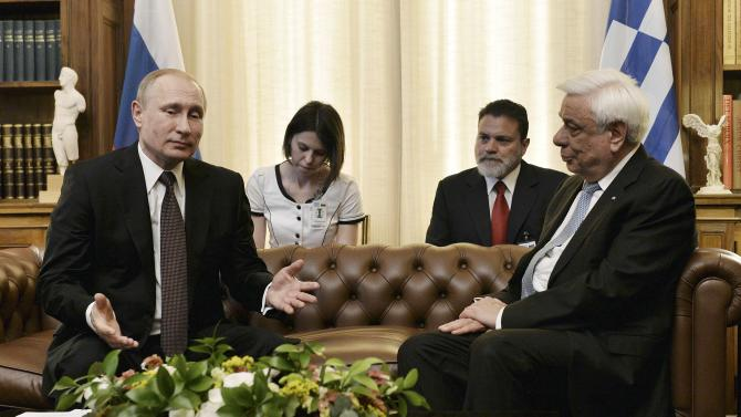 Greek President Pavlopoulos meets with Russian President Putin at the Presidential Palace in Athen