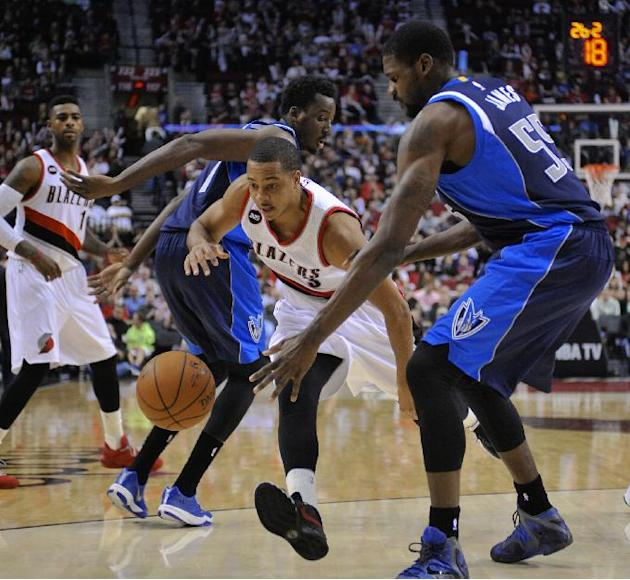 Portland Trail Blazers' CJ McCollum (3) drives against Dallas Mavericks'  Al-Faroug Aminu (7) and Bernard James (55) during the second half of an NBA basketball game in Portland, Ore., Thursda