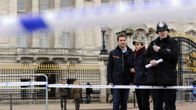 A cornered off area containing knives, a hat and Taser wire outside Buckingham Palace in central London after a man armed with two knives was stunned by police, Sunday Feb. 3, 2013. Scotland Yard said the man, thought to be in his 50s, acted aggressively when challenged by police outside the gates of the heavily touristed landmark on Sunday. Queen Elizabeth II and her husband Prince Philip were at their country retreat, Sandringham Estate, at the time.  (AP Photo/Jonathan Brady/PA)  UNITED KINGDOM OUT - NO SALES - NO ARCHIVES