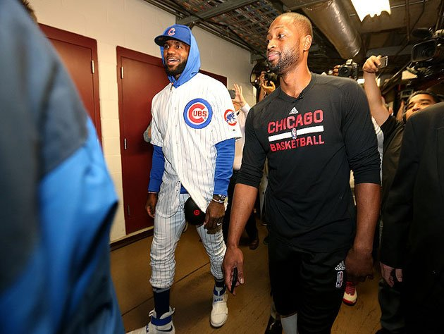LeBron James and Dwyane Wade make their way into work. (Getty Images)
