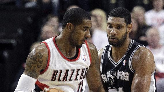 Portland Trail Blazers forward LaMarcus Aldridge, left, works the ball against SanAntonio Spurs forward Tim Duncan during the second half of an NBA basketball game in Portland, Ore., Saturday, Nov. 2, 2013. Aldridge scored 24 points as they defeated the Spurs 115-105