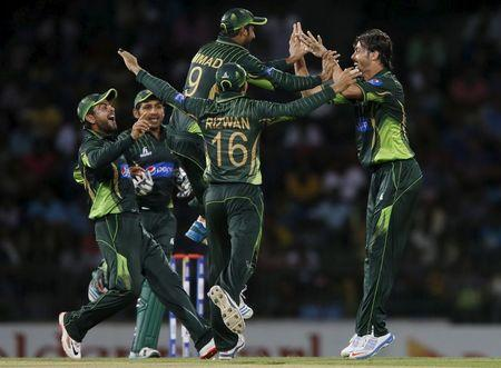 Pakistan's Ali celebrates with his teammates after taking the wicket of Sri Lanka's Dilshan during their third One Day International cricket match in Colombo