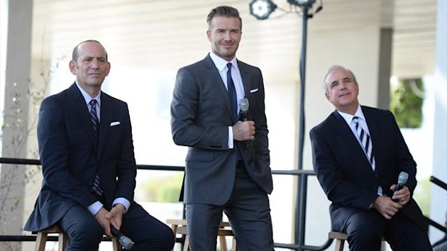 Commissioner Don Garber, David Beckham and Mayor Carlos Gimenez attend a press conference to announce their plans to launch a new MLS franchise in Miami (AFP)