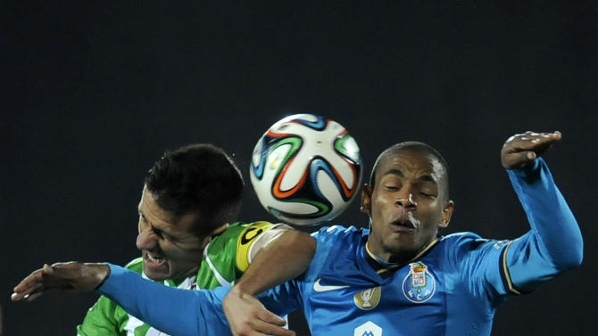 FC Porto's Fernando Reges, from Brazil, vies for a high ball Rio Ave's Bruno Braga, left, in a Portuguese League soccer match, in Vila do Conde, northern Portugal, Sunday, Dec. 15, 2013. Brazilian-born defender Fernando announce yesterday that he received the Portuguese nationally, allowing him to be selected for the Portuguese National soccer team