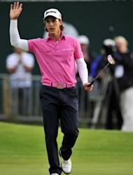 Thorbjorn Olesen of Denmark reacts after making a birdie putt on the 18th green during his second round of the 2012 British Open Golf Championship at Royal Lytham and St Annes in England. Olesen birdied the last two holes to stand fourth on 135, booking himself a Saturday penultimate pairing with Woods